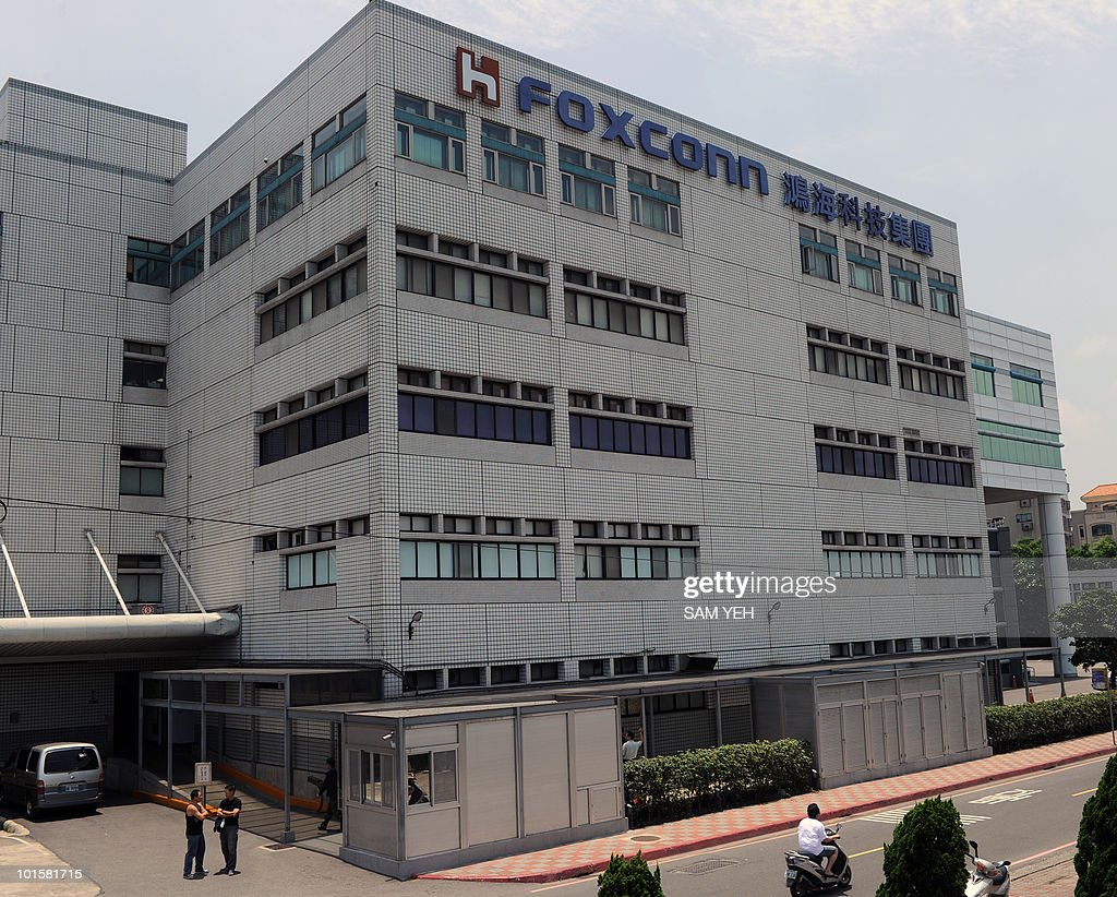 A motorcyclist rides past a Foxconn factory in Tucheng, Taipei county, on May 25. 2010. A 19-year-old employee of Taiwanese technology giant Foxconn fell to his death at the company's plant in southern China -- the tenth such death this year, state media reported. AFP PHOTO/Sam YEH