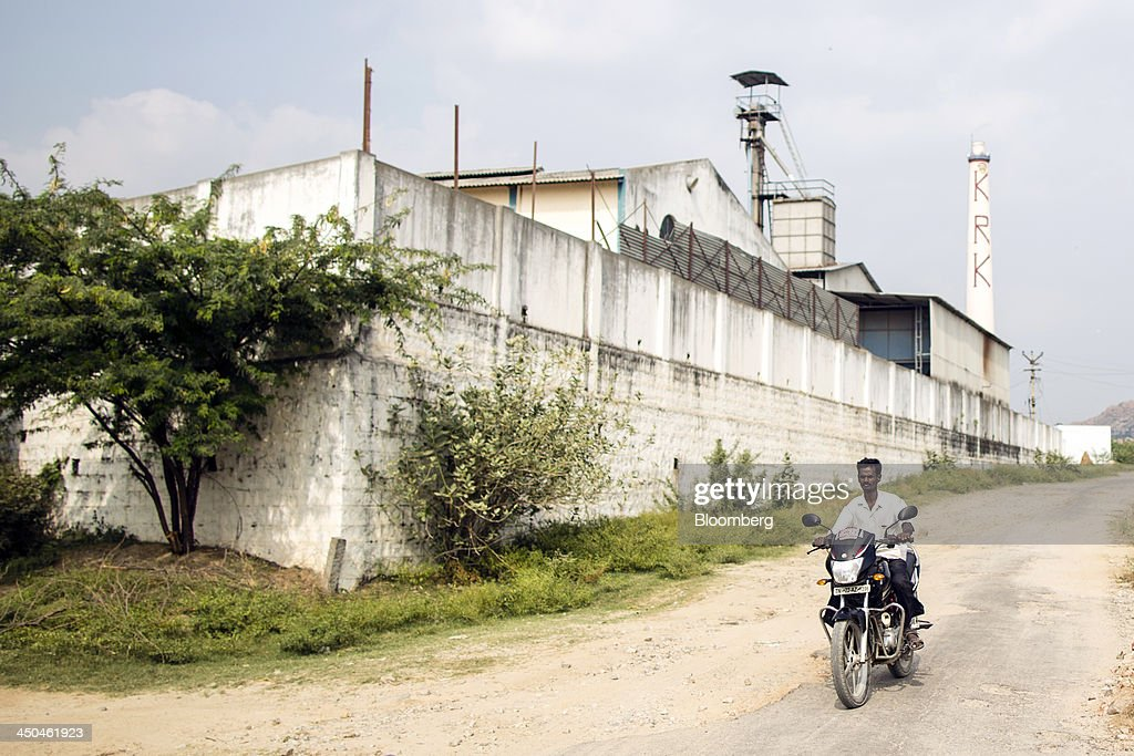 A motorcyclist rides past the KRK Modern Rice Mill in Kothapeta, Tamil Nadu, India, on Thursday, Nov. 14, 2013. Record onion prices and the soaring cost of rice and coriander are frustrating Reserve Bank of India Governor Raghuram Rajans battle to curb inflation while supporting growth in Asias third-largest economy. Photographer: Prashanth Vishwanathan/Bloomberg via Getty Images