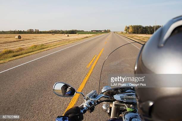 Motorcyclist riding on the highway, near Edmonton