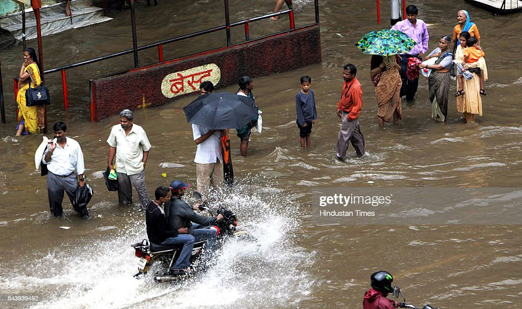A motorcyclist wades through a flooded street near Hindmata Cinema, Parel on July 21, 2005 in Mumbai, India. Heavy rains lashed across the city leaving most of the areas around the city in a flooded state.