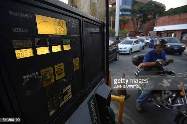 A motorcyclist waits to buy gas in Caracas on February 17 2016 Venezuela's President Nicolas Maduro said Wednesday he would raise the price of...