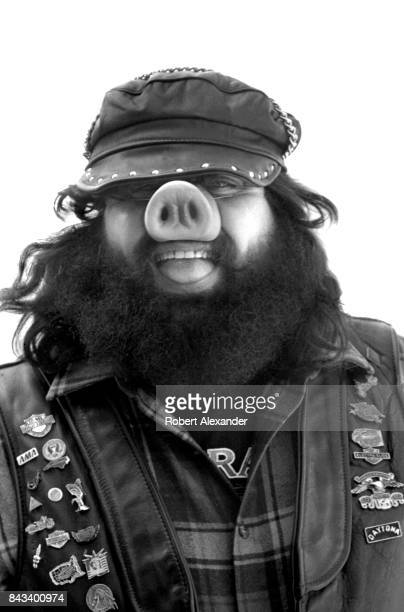 A motorcyclist wearing a pig nose smiles for a photo in Daytona Beach Florida during the city's 1983 Bike Week The annual motorcycle event and rally...