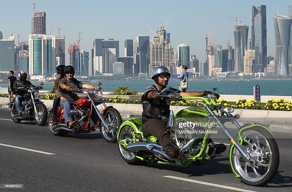 Motorcyclists belonging to the Soul Riders group parade on their Harley Davidson during the last stage of the 2013 cycling Tour of Qatar, from Cyline beach to the Doha Cornich, on February 8, 2013. The 2011 world champion, Cavendish won the 116.5-kilometre final stage in a sprint finish ahead of Yauheni Hutarovich of Belarus and Barry Markus of the Netherlands.