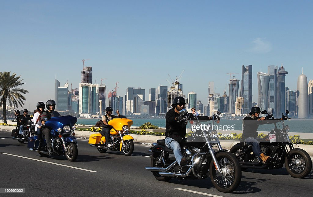 Motorcyclists, belonging to the Soul Riders group, parade on their Harley Davidson during the last stage of the 2013 cycling Tour of Qatar, from Cyline beach to the Doha Cornich, on February 8, 2013. The 2011 world champion, Cavendish won the 116.5-kilometre final stage in a sprint finish ahead of Yauheni Hutarovich of Belarus and Barry Markus of the Netherlands.