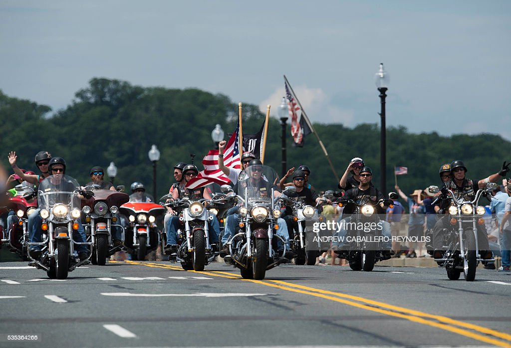 Motorcyclists drive during the annual Rolling Thunder 'Ride for Freedom' parade ahead of Memorial Day in Washington, DC, on May 29, 2016. / AFP / Andrew Caballero-Reynolds