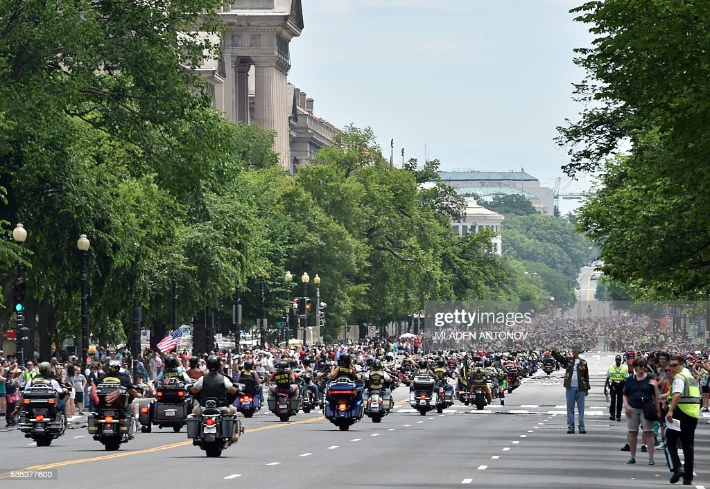 Motorcyclists drive on Constitution Avenue during the annual Rolling Thunder 'Ride for Freedom' parade ahead of Memorial Day in Washington, DC, on May 29, 2016. / AFP / MLADEN