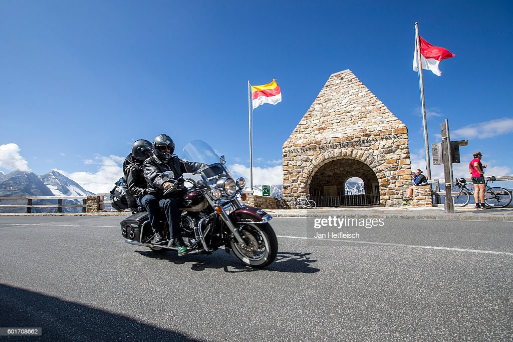 Motorcyclists drive past the Fuscher Toerl on September 08, near Zell am See, Austria. The Grossglockner high alpine road is the highest mountain pass road in Austria. It connects Bruck in the state of Salzburg with Heiligenblut in Carinthia. The road is named after the Grossglockner, Austria's highest mountain (3798 m). The road was build from 1930 to 1935. Humans have been crossing the Alps on a path that mainly follows the modern road for more than 3500 years. Celts, Romans, sumpters, gold diggers and galley slaves got past this strenuous and dangerous path.