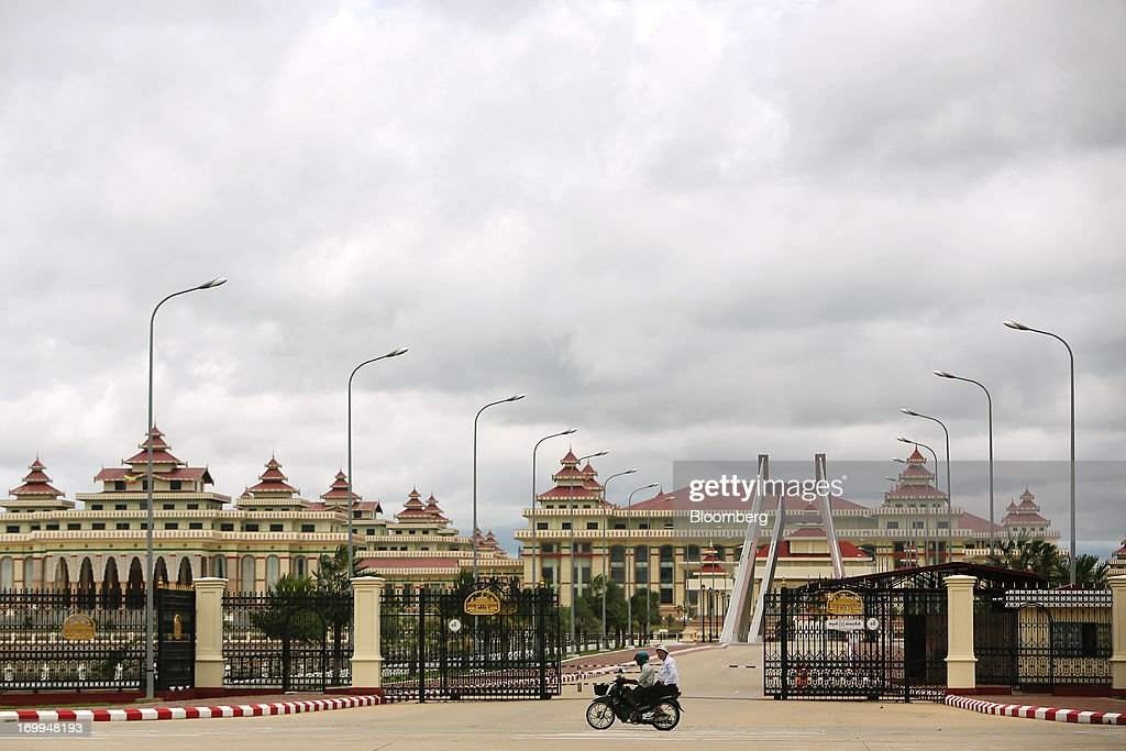 Motorcyclists drive past the Myanmar parliamentary complex in Naypyidaw, Myanmar, on Wednesday, June 5, 2013. Myanmar hosts the three-day World Economic Forum on East Asia starting today, with heads of state and executives from companies including General Electric Co., Coca-Cola Co. and WPP Plc attending. Photographer: Dario Pignatelli/Bloomberg via Getty Images