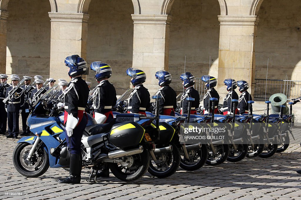 Motorcyclists of a French Gendarmerie unit stand guard on February 18, 2013 at the Hotel des Invalides in Paris, during a memorial cemerony honoring gendarmes who died during service. French Interior minister Manuel Valls reviewed units of the French Gendarmerie during this memorial cemerony. AFP PHOTO / FRANCOIS GUILLOT