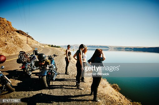 Motorcyclists on road trip stopped at overlook