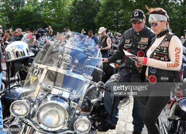 Motorcyclists read along during prayers at the 'Blessing of the Bikes' at the Washington National Cathedral May 26 2017 in Washington DC / AFP PHOTO...