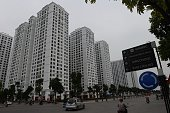 Motorcyclists ride at the newly developped residential quarter Times City in Hanoi on October 23 2014 Vietnam's economy is expected to expand 58...