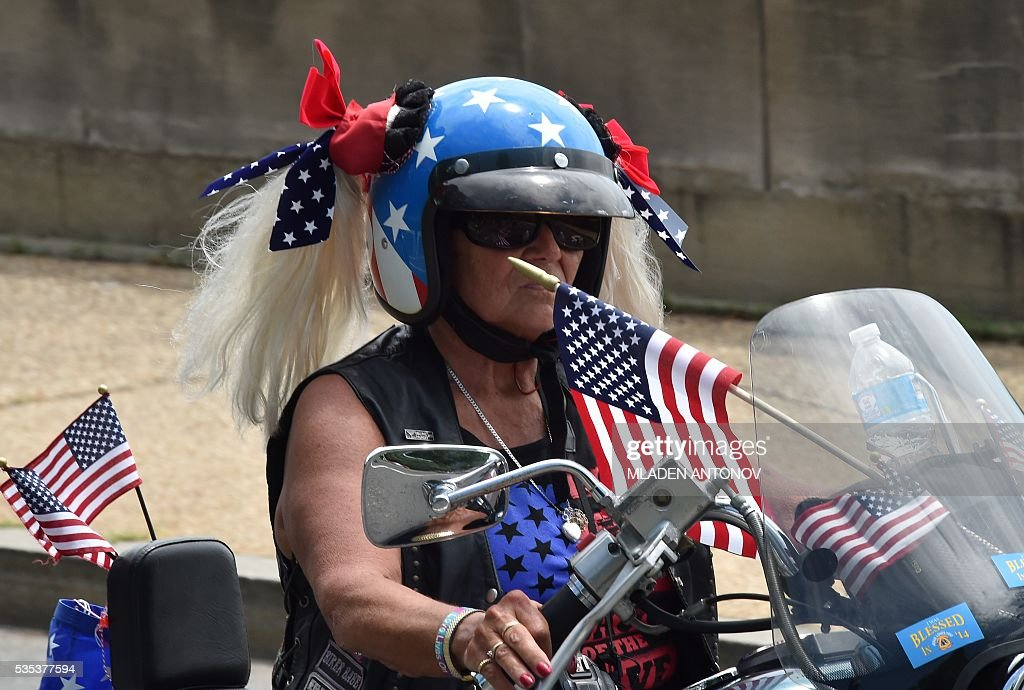 Motorcyclists ride their bikes during the annual Rolling Thunder 'Ride for Freedom' parade ahead of Memorial Day in Washington, DC, on May 29, 2016. / AFP / MLADEN