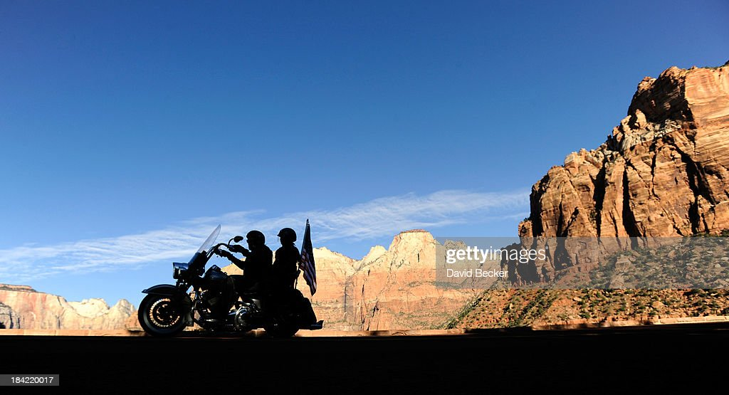 Motorcyclists ride through the now opened Zion National Park on October 12, 2013 in Springdale, Utah. The Obama administration said it would allow states to use their own money to reopen some national parks after a handful of governors made the request. Utah Gov. Gary Herbert said he reached an agreement to pay $166,572 a day to the Interior Department to open eight national sites in Utah.
