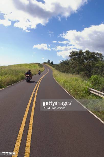 Motorcyclists riding on country road