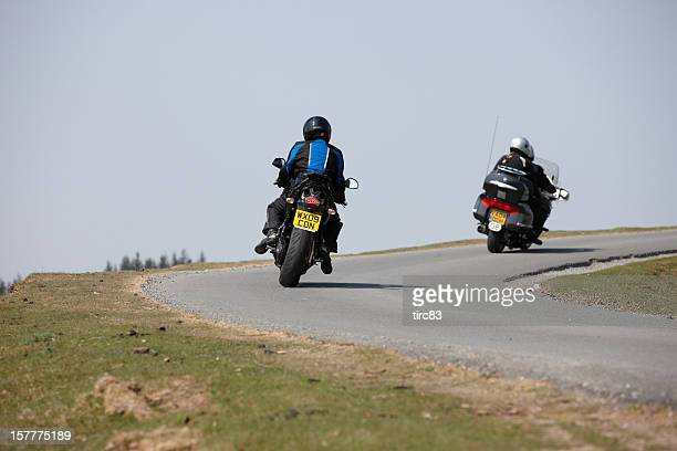Motorcyclists taking a bend on remote Welsh mountain road