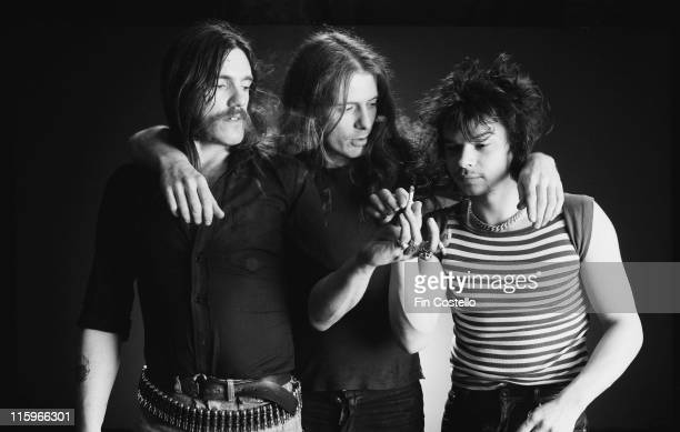 singer and bassist Lemmy Kilmister guitarist Eddie Clarke and drummer Phil Taylor British heavy metal band pose with Clarke with his arms around...