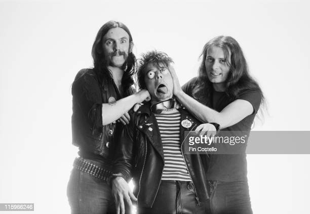 singer and bassist Lemmy Kilmister drummer Phil Taylor and guitarist Eddie Clarke British heavy metal band pose with Lemmy and Clarke appearing to...