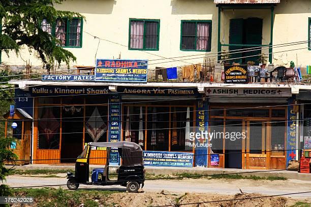 Motorickshaw pharmacy and pashmina shops in Nagar village Kullu Valley Himachal Pradesh India