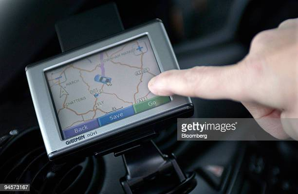 A motorist checks a Garmin satellite navigation system operating in a car in Norfolk UK on Wednesday Oct 31 2007 Garmin Ltd the biggest US maker of...