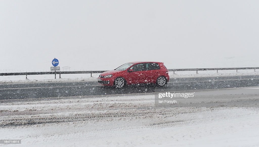 A motorist drives in snowy conditions on the A66 near to Bowes in County Durham on March 27, 2013 in northern England. Across the UK heavy snow and freezing temperatures continue to cause disruption as Britain endures the coldest March in 50 years.