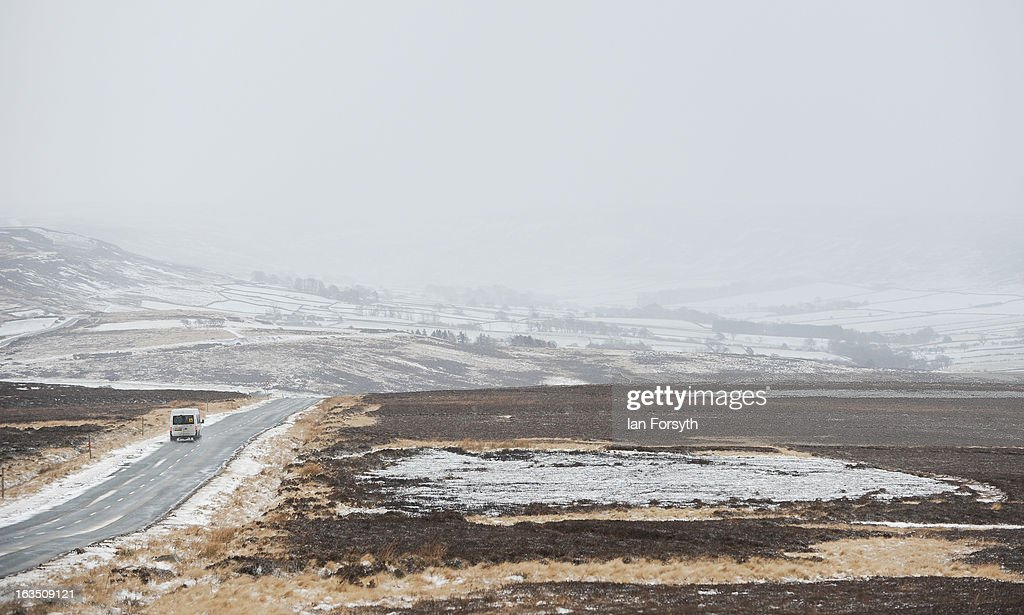 A motorist drives on a snow covered road as brief but heavy snow storms move across the Yorkshire Moors on March 11, 2013 in Yorkshire, United Kingdom. Wintery weather returned to the UK as snow fell across many parts of the country, with a number of weather warnings being issued. (Photo by Ian Forsyth/Getty Images)y Images)