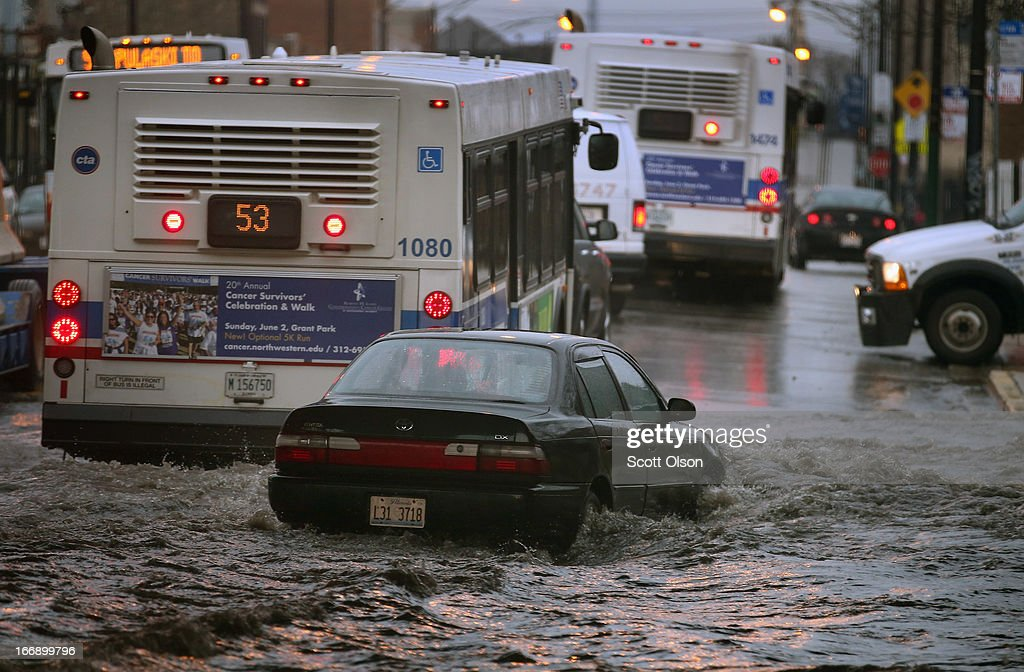 A motorist drives through standing water in a flooded underpass on April 18, 2013 in Chicago, Illinois. Thunderstorms dumped up to 5 inches of rain on parts of the Chicago area overnight, closing sections the Edens, Eisenhower and Kennedy expressways, which lead into downtown, during the morning rush.