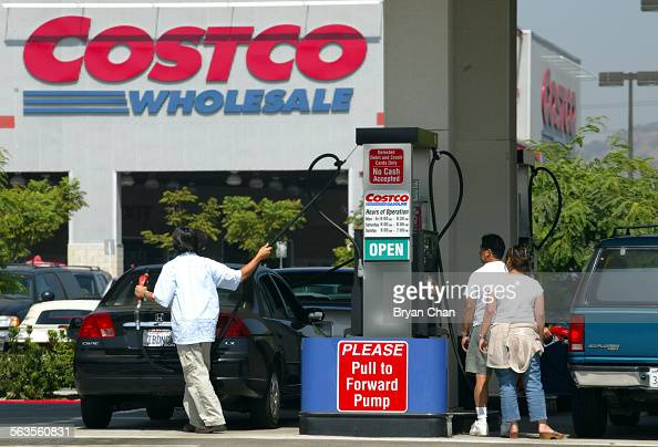 Motorist fill up at the Costco Wholesale gas pumps in Burbank Los Angeles Times Photo by ^^^