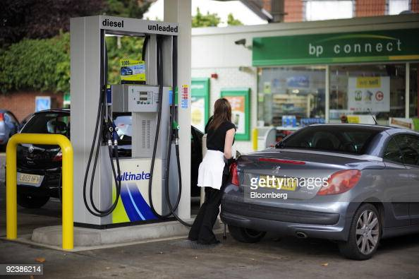 A motorist fills her automobile with unleaded gas at a fuel station in London UK on Tuesday Oct 27 2009 BP Plc Europe�s secondlargest oil company...