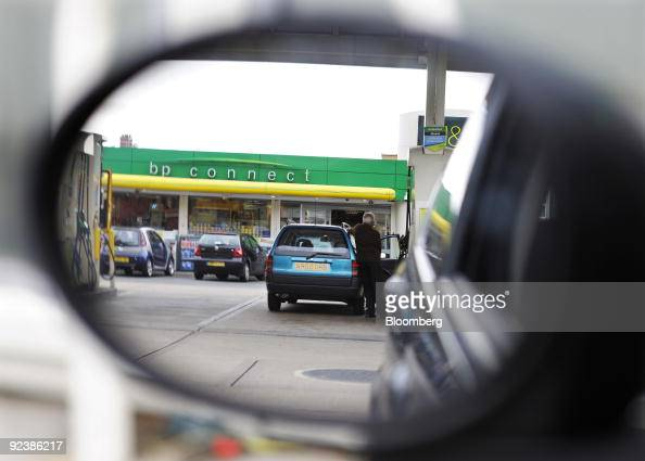 A motorist fills his automobile with unleaded gas at a fuel station in London UK on Tuesday Oct 27 2009 BP Plc Europe�s secondlargest oil company...