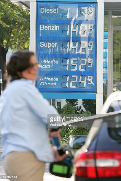 A motorist fills up her car at a gas station on September 5 2005 in Berlin Germany Gasoline prices in Germany are at a record high in the wake of...