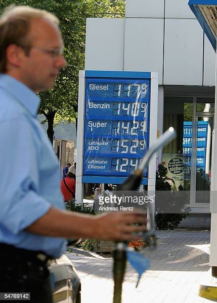 A motorist fills up his car at a gas station on September 5 2005 in Berlin Germany Gasoline prices in Germany are at a record high in the wake of...