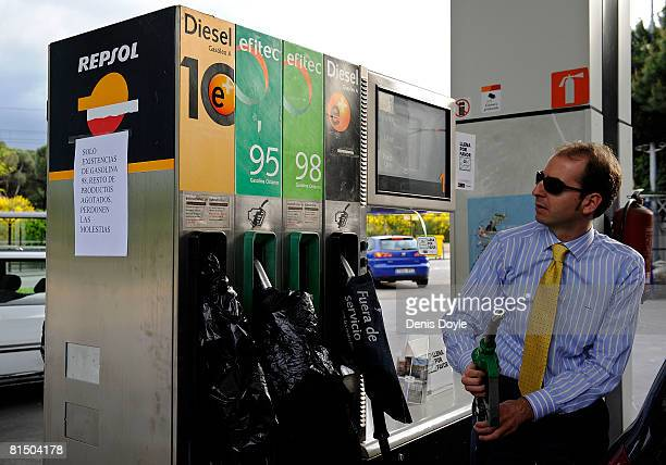 A motorist fills up his car at a petrol station in Madrid during the first day of a nationwide haulers strike on June 9 2008 in Madrid Spain Spanish...