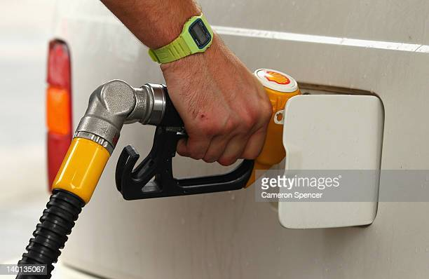 A motorist fills up petrol on February 29 2012 in Sydney Australia An NRMA survey of over 1300 drivers revelaed one in ten people have paid damage...