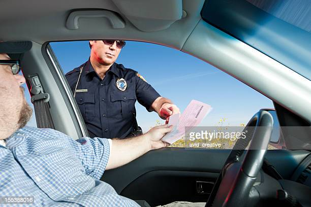Motorist Handing Police License and Registration