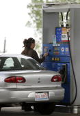 A motorist prepares to pump gas into her car at a Mobil gas station along Interstate 90 September 01 2006 in Des Plaines Illinois According to...