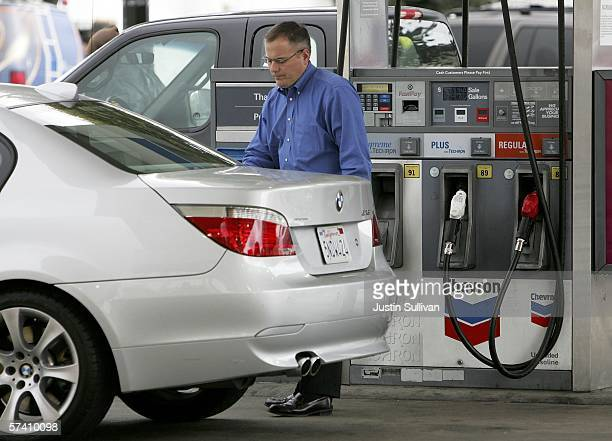 A motorist pumps gas into his car at a Chevron gas station April 24 2006 in San Francisco California Gas prices shot up over 25 cents in the past two...