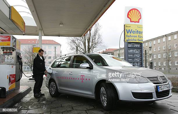 A motorist pumps gas into his car at a Shell gas station on March 31 2008 in Berlin Germany Deutsche Telekom's enterprise customer unit TSystems...