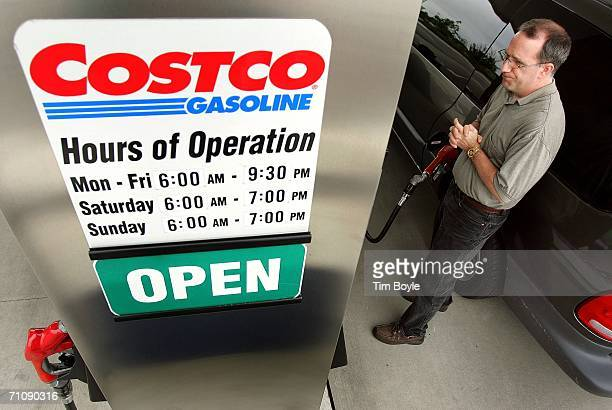 A motorist pumps gasoline into his van at a Costco Wholesale store's gas station May 31 2006 in Mount Prospect Illinois Thirdquarter earnings...