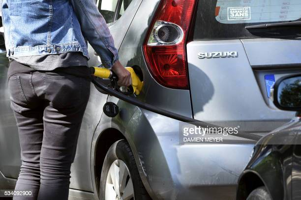A motorist refuels at a gas station in Rennes western France on May 25 as widespread blockades of oil depots as part of strikes over labour reforms...