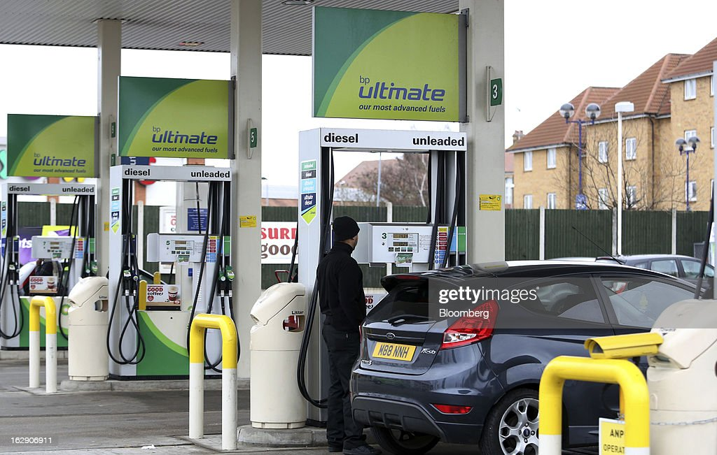 A motorist refuels his Ford Fiesta automobile with unleaded gasoline at a BP gas station, operated by BP Plc, in Newbury Park, U.K., on Thursday, Feb. 28, 2013. BP Plc's push to maximize profits and cut costs at the Macondo well was a 'root cause' of the explosion that led to the 2010 Gulf of Mexico oil spill, a safety expert who studied the disaster said. Photographer: Chris Ratcliffe/Bloomberg via Getty Images