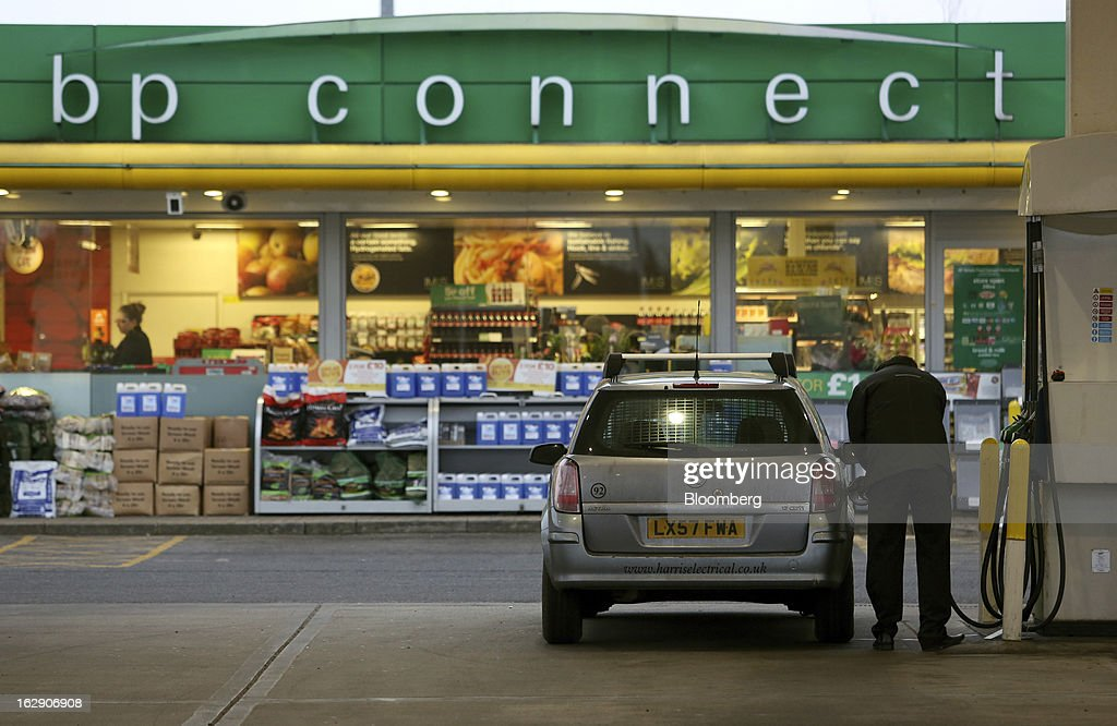 A motorist refuels their automobile with fuel at a BP gas station, operated by BP Plc, in Upminster, U.K., on Thursday, Feb. 28, 2013. BP Plc's push to maximize profits and cut costs at the Macondo well was a 'root cause' of the explosion that led to the 2010 Gulf of Mexico oil spill, a safety expert who studied the disaster said. Photographer: Chris Ratcliffe/Bloomberg via Getty Images