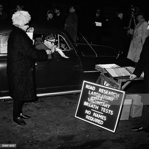A motorist stops to take a voluntary breath test which has been set up as part of an experiment by the Road Research Laboratory Dorking England 2nd...