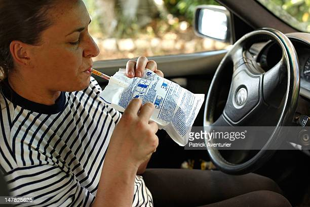 A motorist uses the breathalyser on July 4 2012 in Nimes France A law voted during former government of Nicolas Sarkozy orders car drievrs to have...