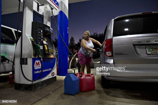 A motorist who waited 5 hours to get fuel fills her vehicle at a Marathon gas station in Estero Florida US on Tuesday Sept 12 2017 Seven million...