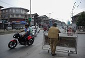 Motorists and pedestrians return to downtown Srinagar streets after authorities lifted a curfew in Srinagar on July 26 2016 Authorities lifted a...