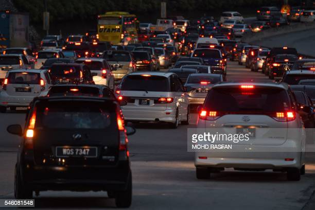 Motorists are caught in a traffic jam as they return to the city following the Eid alFitr holidays along a highway in Bentong outside Kuala Lumpur on...
