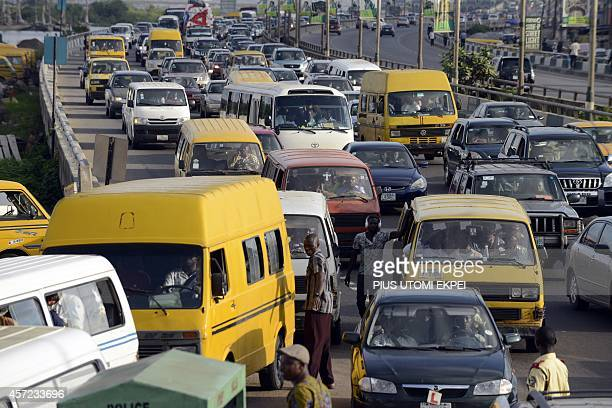 Motorists are stuck in traffic jam on October 13 tempting them to use their horns to hasten the flow of traffic in Lagos October 15 has been declared...
