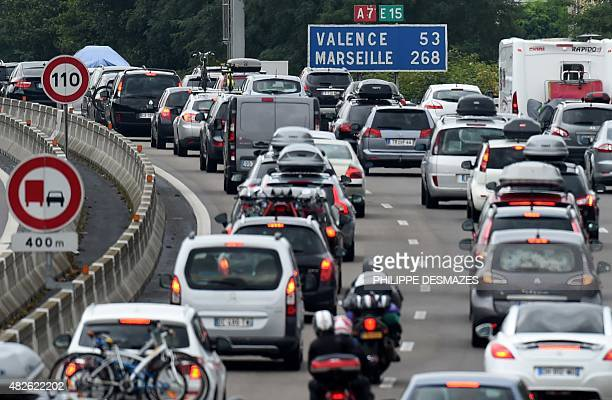 Motorists drive in traffic on the A7 motorway on August 1 2015 between Vienne and Valence southeastern France during the busiest weekend of the...
