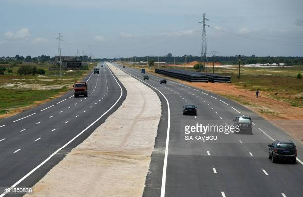 Motorists drive on a new highway between Abidjan and Grand Bassam on October 8 2015 AFP PHOTO / SIA KAMBOU